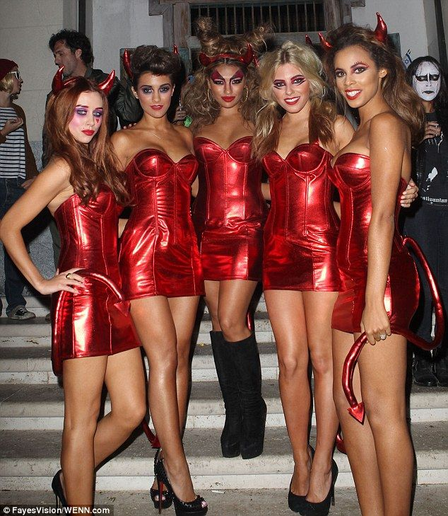 The Saturdays dressed as slutty devils in little red costumes for Halloween.