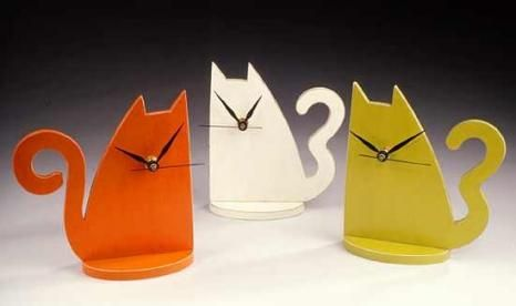 Check out these gorgeous handmade cat clocks! So cute! http://moderncat.com/favefind/wooden-cat-clock