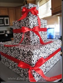 Cute idea for a cupcake stand! Wrap boxes in your choice of wrapping paper and add ribbon!
