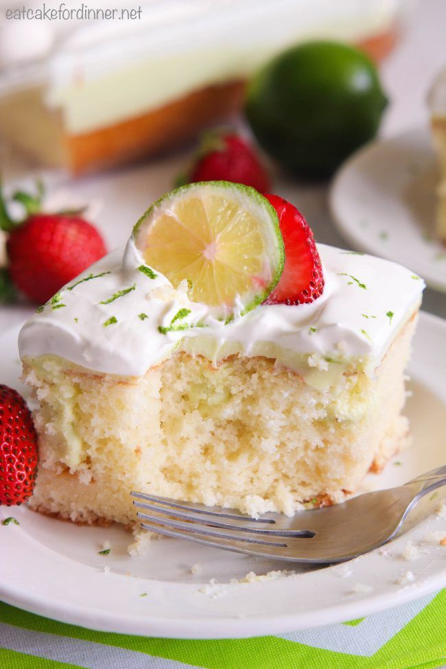 Key Lime Poke Cake is a delicious white cake that is seeping with a sweet and tart mixture that soaks into the holes.  Topped with fresh whipping cream and strawberries this makes a delicious dessert!