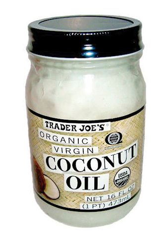 """Coconut Oil While jojoba oil gets rave reviews from most curly and natural-hair bloggers, coconut oil comes in a very close second for its ability to reduce dandruff and help heal a dry scalp. """"Coconut oil is a little harder to work with because it's often a solid at room temperature, but it's worth it,"""" says Stevens. """"I use it in deep treatments for the hair and on my scalp as well. It's one of the few oils with small enough molecules that will penetrate the hair shaft."""""""