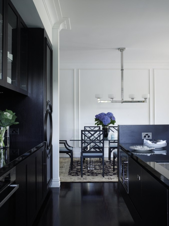 black kitchen , with panelled fridge door & white dining area - Perfection!