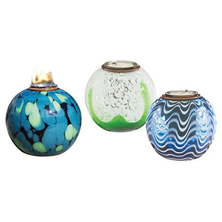 """With a beautiful abstract motifs, these eye-catching glass firepots bring artful appeal to your poolside accent table or front porch railing. Set of 3.  5.51""""D x 5.12""""H"""