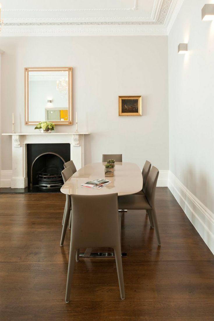 Granite Dining Table at Gardens House with Darkwood Floor and Leather Carpet…