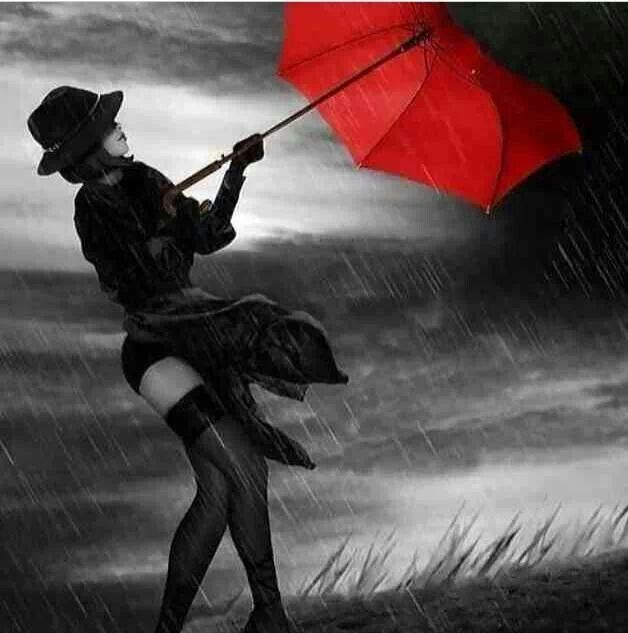 Red umbrella in the wind