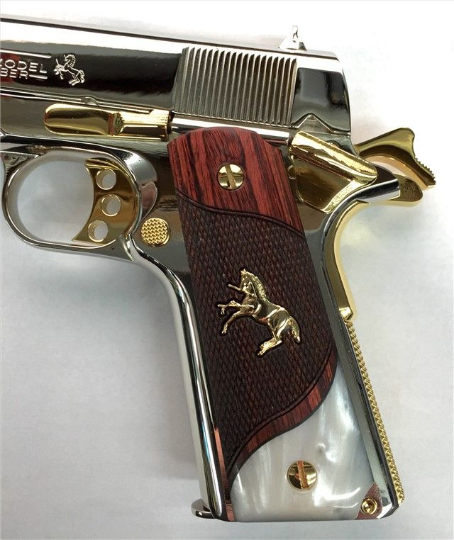 Colt 1911 A Government Model that was hand polished, then nickel plated, finally having accent parts gold plated.