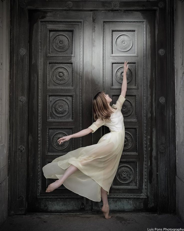 """Luis Pons Photography @abtofficial Ballerina Rachel Richardson Dress by @valentina_kova We saw this door earlier in the morning and I decided to skip it, I felt there was something missing. At the end of our shoot I drove back and thought, """"I want to see the door again"""" and there was this really beautiful light on the top right of the door and I thought, """"ok.. now we can shoot here"""""""
