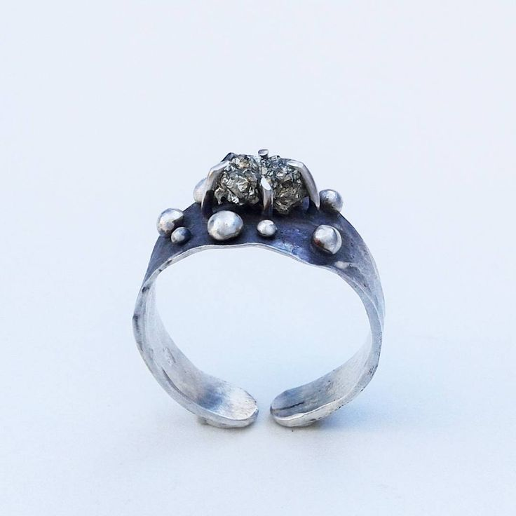Sterling silver ring set with silver drops and raw pyrite. It has been oxidized for a more dramatic look.