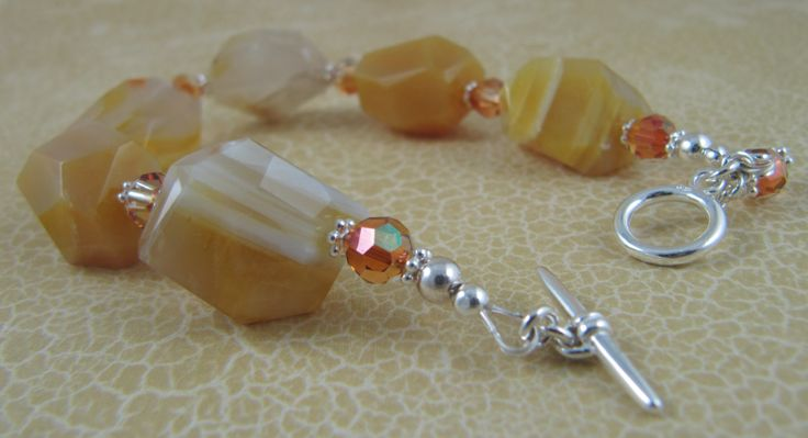 Bracelet with honey agate chunks, Swarovski crystals, and sterling silver spacers and findings.