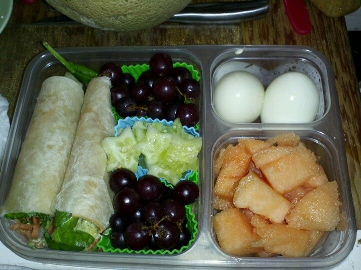 Spinach avocado cheese and tomato wraps with grapes melons cucumbers and eggs for sides adult bento lunch using Ziploc divided lunch containers