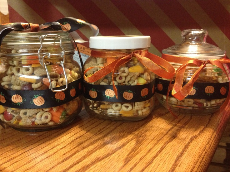 Made these fall snack mix jars for my daughter's fall fest bake sale! Just combined all ingredients, put in small canisters, and hot glued fall ribbon around them!