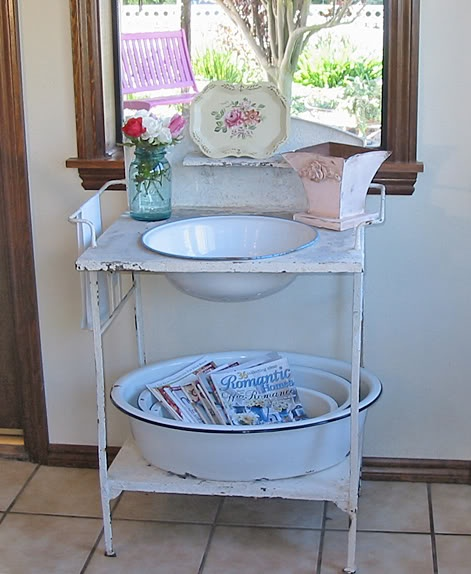 Another vintage wash stand with enamelware in my kitchen kathee  chateauetjardin.blogspot.com   I have one available in green at American Home & Garden in Ventura CA