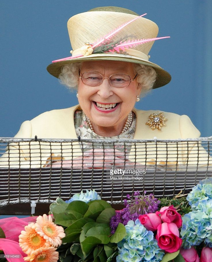 Queen Elizabeth II watches the racing from the balcony of the Royal Box as she attends Derby Day during the Investec Derby Festival at Epsom Racecourse on June 6, 2015 in Epsom, England.