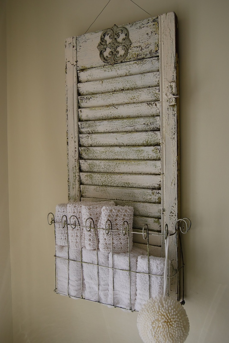 hanging vinatge shutter with metal basket, good idea to add both those pieces