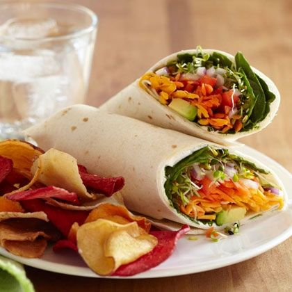 Veggie Wrap - Ingredients:      1 tablespoon spreadable cream cheese     1 large flour tortilla, regular or flavored     2 tablespoons shredded carrot     2 tablespoons thinly sliced red or yellow pepper     2 tablespoons chopped red onion     1/4 cup shredded cheddar or Monterey Jack cheese     1/4 avocado, peeled and sliced     1/4 cup baby spinach leaves (or torn arugula)     1/4 cup alfalfa sprouts     Salt and pepper to taste #food #yummy #delicious