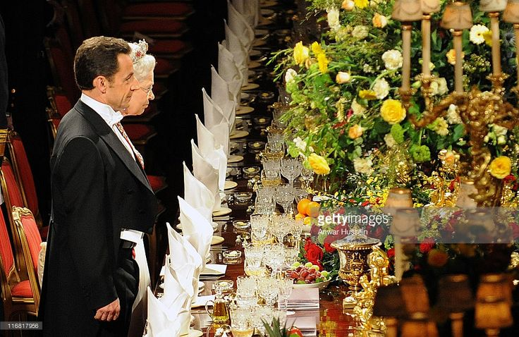 Queen Elizabeth II and French President Nicolas Sarkozy stand together during the state banquet on March 26, 2008 at Windsor Castle in Windsor, England. President Sarkozy and Carla Bruni-Sarkozy are on a two day state visit to the United Kingdom, comprising events in London and Windsor