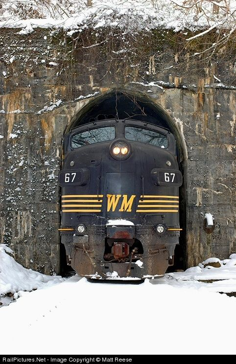 Tight fit, West Virginia Central Railroad EMD FP7 emerges from Kelly Tunnel near Elkins, West Virginia....