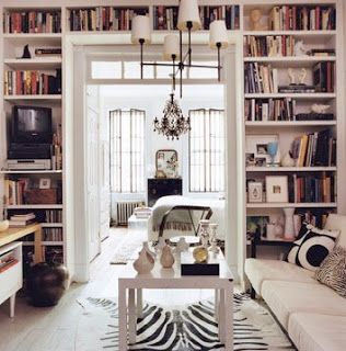 A zebra rug is used perfectly to give this modern living room a more glam vibe