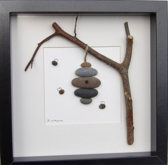 Beautiful pebble picture using a mixture of natural materials.  In this picture you see the little pebble bees busily flying in and out of their pebble beehive.  It is made in the Scottish Borders using natural materials gathered locally. Using natural material means that no two pictures will ever be quite the same, making this a completely unique addition to any room.  The picture size, including frame, is 25x25cm  If you are outside the UK, please contact me for shipping costs. All parcels…