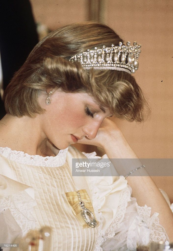 Princess Diana, Princess of Wales, wearing a tiara, looking tired during a visit in New Zealand in April 1983.