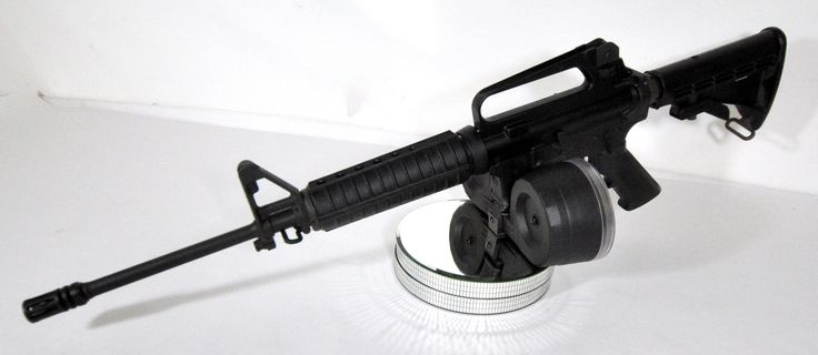 """Bushmaster Model XM15-ES2 with 100-Round Mag .223 / 5.56 16"""". Special combo. A Bushmaster M4 type carbine, semi-automatic rifle modeled on the AR-15 platform. The rifle accepts both .223 Remington and 5.56x45mm cartridges. Features a 6-position telescopic stock, A2-style sights, and includes a NEW 100-round 5.56 magazine. $1149.99"""