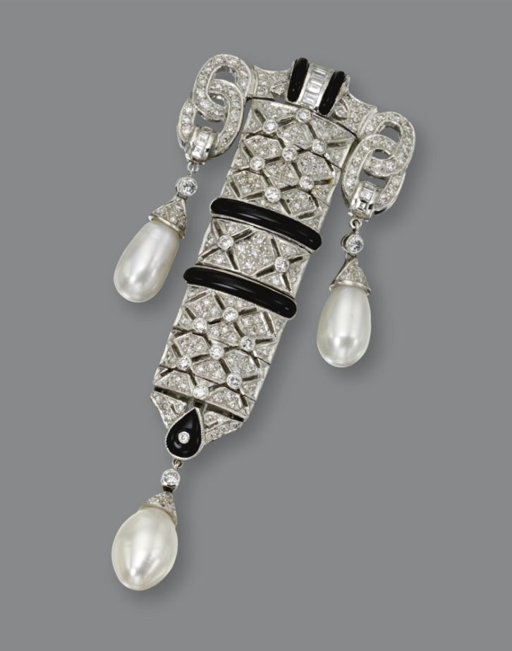 ART DECO DIAMOND, ONYX & CULTURED PEARL PENDANT-BROOCH The articulated pendant of geometric design set with 185 small round & baguette diamonds weighing approx 1.45 cts, accented further with bands of black onyx & 3 cultured pearl drops, in 18kt white gold, supported on an 18kt white gold chain. | Sotheby's