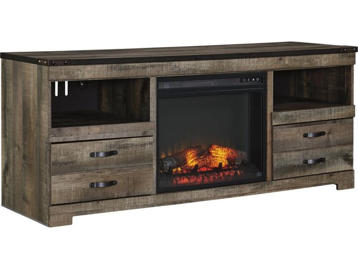 Replicated oak grain takes the look of rustic reclaimed wood on this large TV stand with an electric fireplace insert. Its top metal banding with rivet look at the corners and simple metal drawer hardware amplifies the cool character of the TV stand. Plentiful storage and wire management openings allow you to connect your components with ease. The fireplace insert has LED technology and a remote control with LED display. Its realistic wood burning flame effect combined with life-like logs…