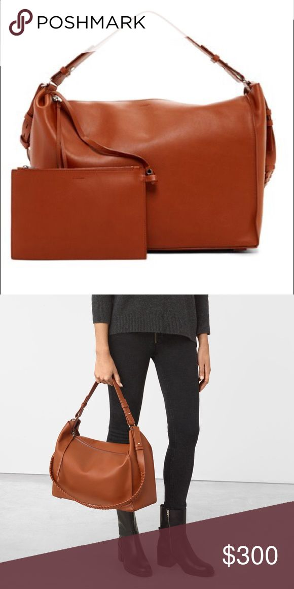 AllSaints Kita East/West  Leather Tote & Pouch AllSaints Kita East/West  Leather Tote & Pouch. new color is Sienna Brown comes with a detachable pouch. Has zip top closure.Open to reasonable offers All Saints Bags Totes