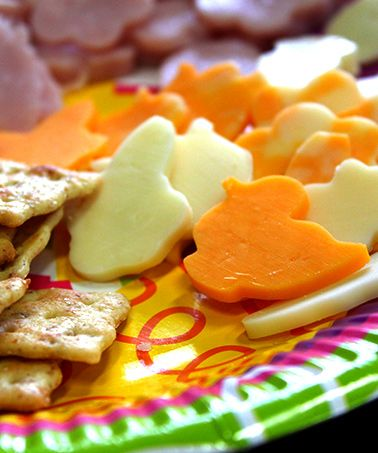 EASTER THEMED MEAT AND CHEESE TRAY A meat and cheese tray is always a welcome addition to table. Brighten things up by cutting your ham and cheese in holiday shapes. To keep this snack healthy, choose the right crackers. Here are some of our favorites:     Triscuit – Whole Grain or Hint of Salt     Snack Factory Pretzel Crisps     Wasa Crispbread     Town House Flatbread Crisps  http://blog.integracareclinics.com/blog/bid/382787/Healthy-Snacks-and-Treats-for-any-Easter-Celebration