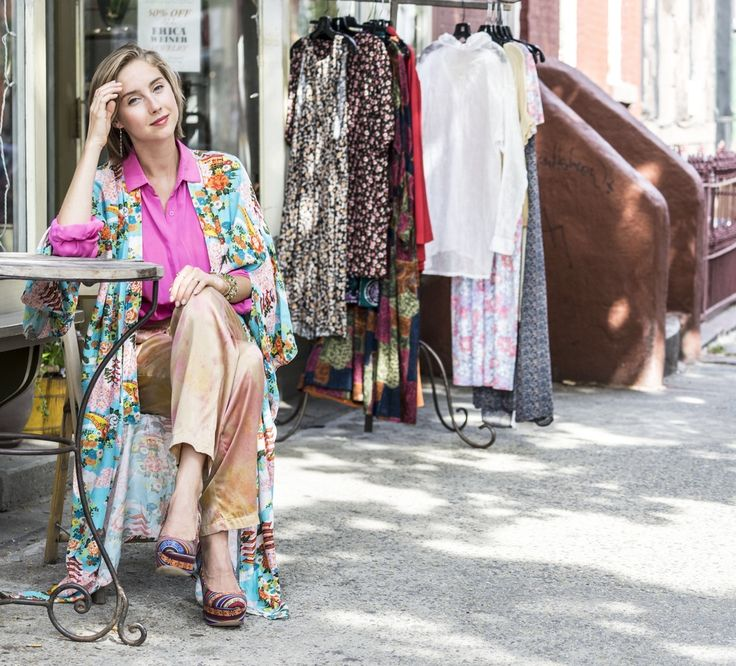 Swedish Nova Landeaus sitting in front of her and her mother's vintage shop in Brooklyn