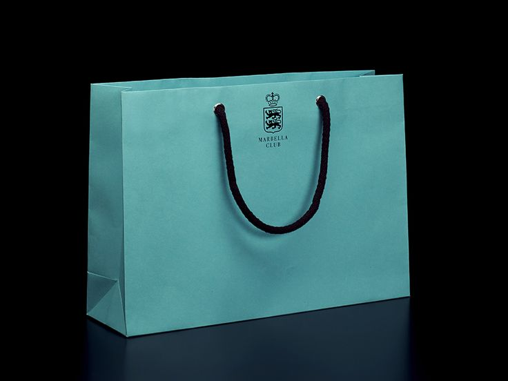 Logo and shopping bag designed by Pentagram for Spanish hotel, golf club and spa resort Marbella Club