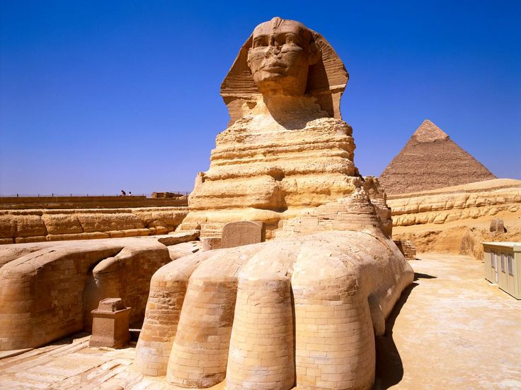 """The Great Sphinx of Giza is a large half-human, half-lion statue in Egypt, on the Giza Plateau at the west bank of the Nile River near Cairo. The commonly used name """"Sphinx"""" was given to it based on the Greek creature with the body of a lion, the head of a woman and the wings of an eagle, though this sphinx have the head of a man. It is one of the largest single-stone statues on Earth, and is commonly believed to have been built by ancient Egyptians in the 3rd millennium BC."""