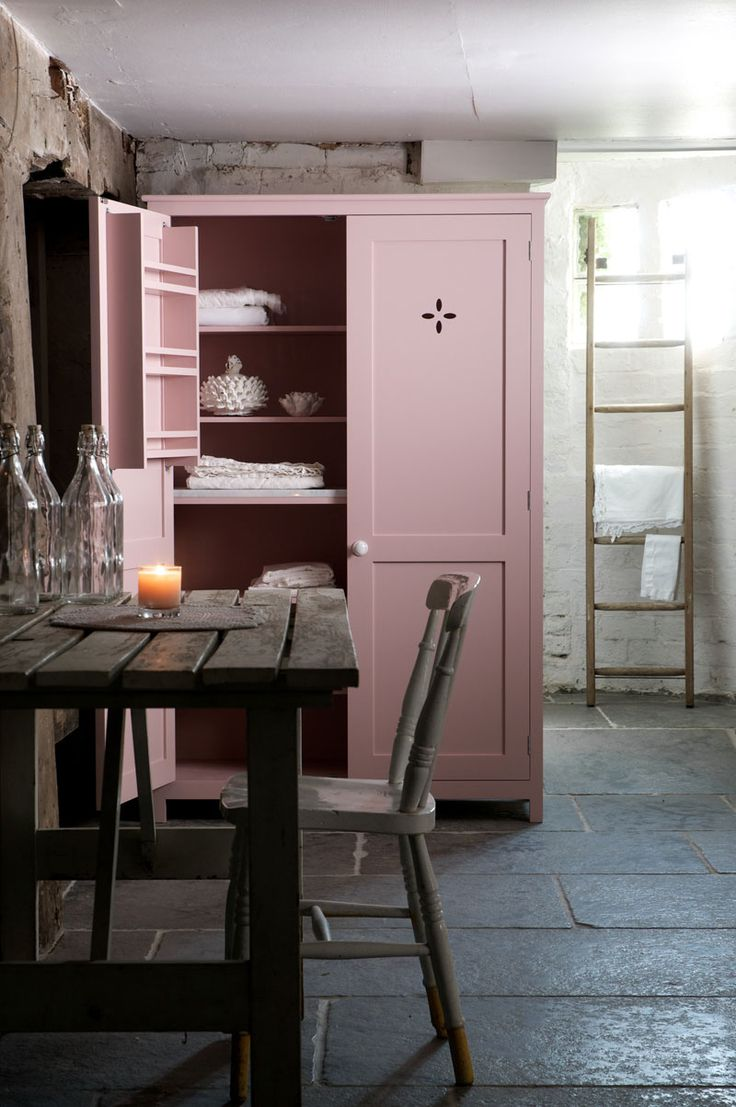 deVOL's pink pantry cupboard, painted in Fired Earth's 'Parlour Rose'.