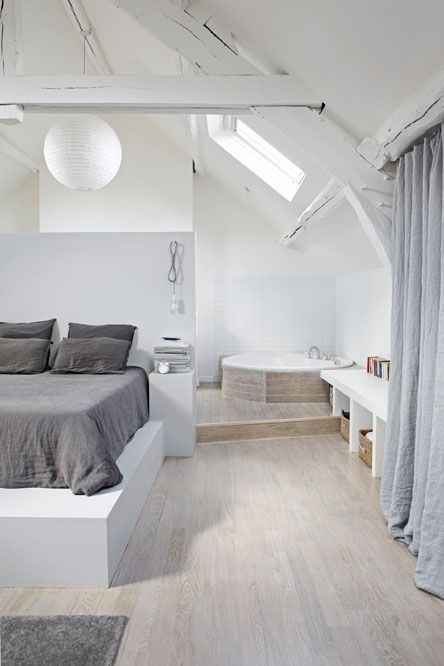 grey and white bedroom with corner tub