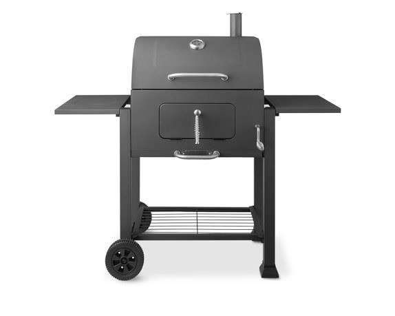 9 GRILLING ESSENTIALS FOR YOUR NEXT BACKYARD BARBECUE| Landmann's Napa charcoal grill looks sleek as can be in cast-iron, and is perfect for low-temperature, slow-cook-time dishes like barbecued ribs; $400. williams-sonoma.com... - Courtesy of Williams-Sonoma
