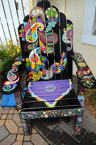 "Description of . A chair titled ""Playful Paisley"" by Ashley Hadfield  sits in front of Eichten's Market & Bistro in Center City. (Pioneer Pr..."