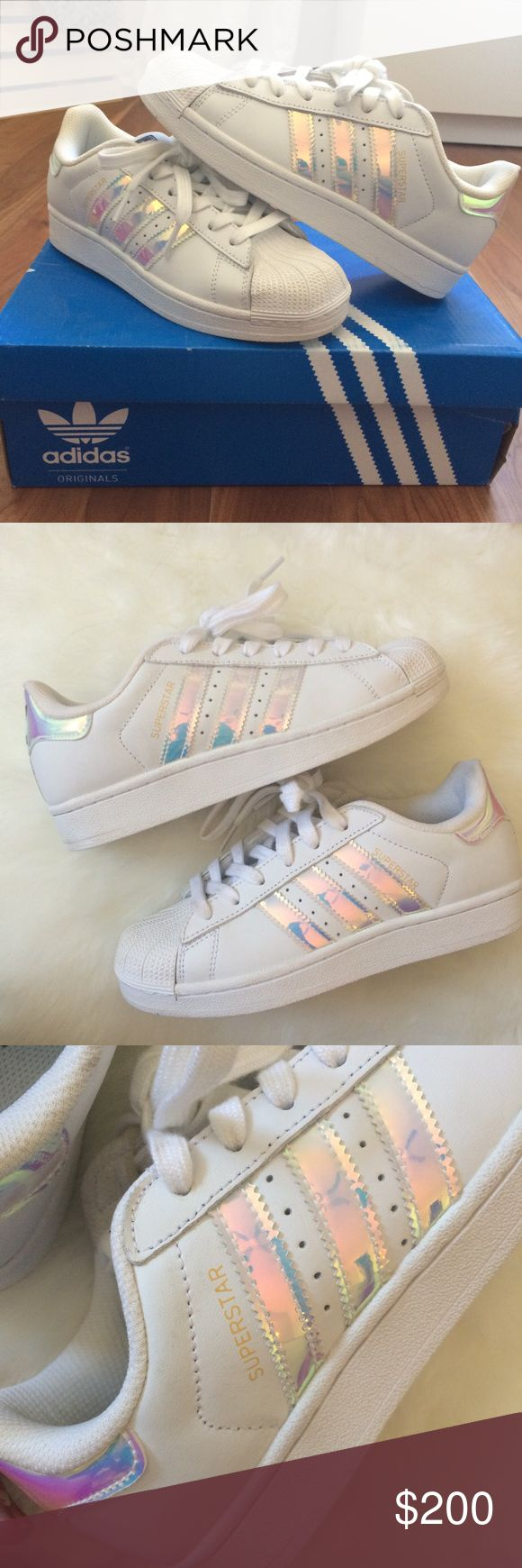 RARE Holographic Adidas SUPER RARE AND HARD TO FIND Holographic Adidas Superstars!!! 100% authentic. These are in a children's 4 which fits a 5.5 or a 6 in women's. These have NEVER BEEN WORN! I've stepped outside in them once but never actually worn them for a full day outside. These are in PERFECT condition. These are super hard to find and limited edition so they don't make them anymore. ✨✨✨✨💓 adidas Shoes Sneakers