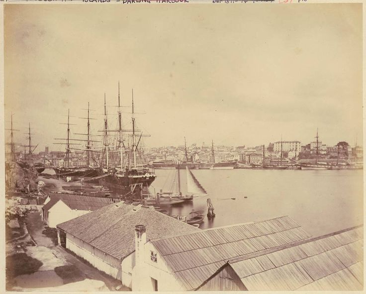 """""""View from Bennelong Point, showing from left the Tarpeian Rocks, the tower of St Phillip's church, the original Customs House, The Commissariat Store barely visible through the mesh of ship rigging, and The Rocks across Sydney Cove, with Campbell's Cove behind the ship far right."""" State Library, NSW, c 1870."""