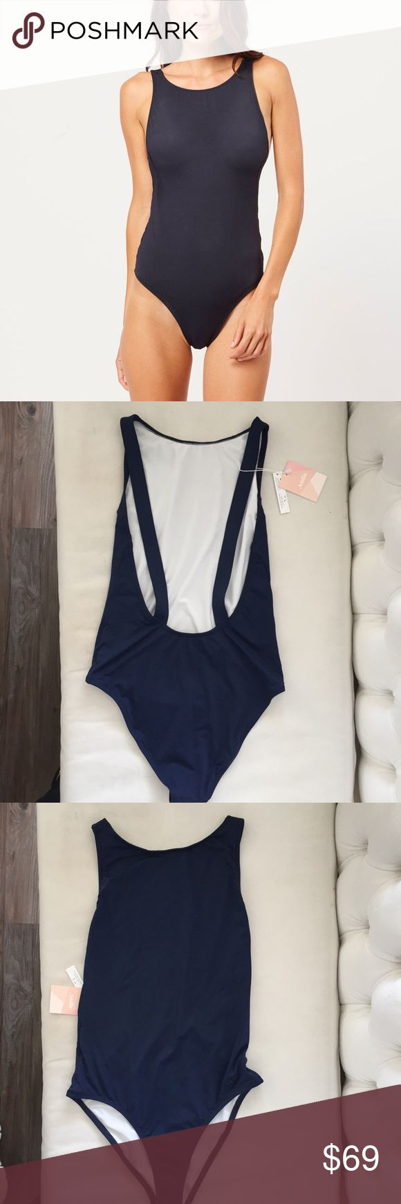 The Montauk - Navy One Piece swimsuit. Size Large. The Montauk - Navy One Piece swimsuit, size Large/8-10. brand new with tags and hygiene sticker. Retail current online -$125.00 A high boat neckline, low scoop back, this fan favorite is effortlessly chic. designed with a high-cut hip and light coverage at the back.  Fabric is milled in north carolina from a high-quality blend of 25% spandex and 75% nylon, with a lycra-polyester jersey lining. Andie Swim One Pieces