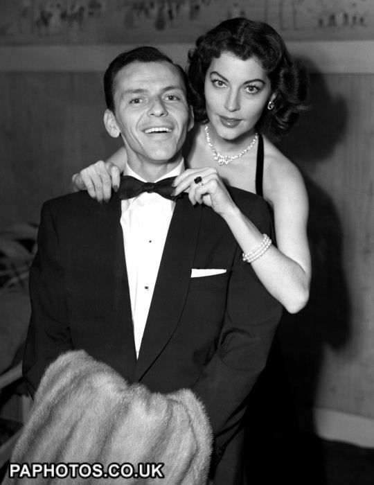 Ava Gardner an Frank Sinatra's tie before they leave the Washington Hotel, Mayfair, London, for the Midnight Matinee at the London Coliseum, 1951?