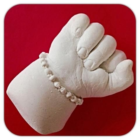 Capture every detail of your baby's teeny tiny hand and jewellery too!   Using Belly Art Hands and Feet Casting Kit.