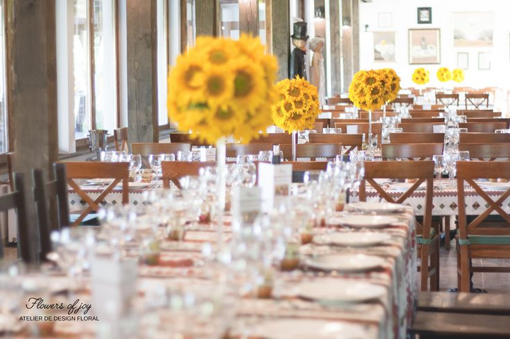 Sunflower arrangements and traditional Romanian table setting.