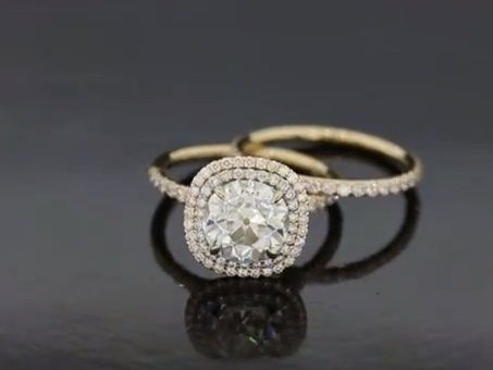 One of our amazing wedding sets, shown here in two tone yellow gold and platinum with an OEC moissanite center.  The double halo adds fabulous finger coverage and sparkle. This set can be made in any metal with your choice of size/shape center.  Available as a set or each piece separately. Price for setting only.