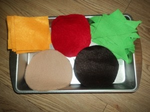 Fun idea - use felt cut-outs in the kitchen center (build your own hamburger)