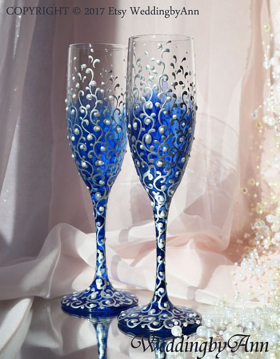 """Listing for toasting flutes, set of 2  The perfect decoration for the top table at your wedding. A beautiful pair of toasting flutes for the bride and groom, made by hands perfectly complement your wedding ceremony. Glasses are painted with special transparent paint, decorated with silver scrolls and pearls, the colors are playing on the sun, unfortunately photos can not convey it.  Glasses will be a luxurious accessory for you wedding, as well as an unique gift.  Height of the glasses 8.5""""…"""
