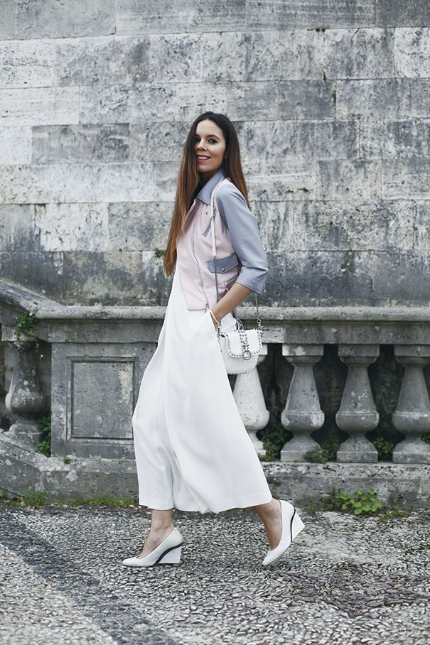 Culottes are my favourite trousers this season, and are perfect for summer! Here I'm wearing a white jumpsuit with culotte trousers, a colourful biker jacket and whit accessories!