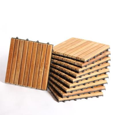 These interlocking teak tiles are great for an impromptu deck. | $74