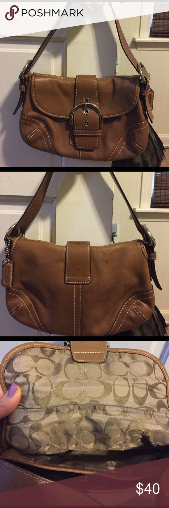 Authentic Coach light brown leather shoulder purse Authentic Coach light brown leather shoulder purse, Coach logo C's fabric lining throughout inside of purse, 2 inner sections with several pockets including one interior side zip pocket. Some small stains on back of purse and small at top of bag but rest is in great condition! Send me an offer today! 😊👍🏻 BONUS Coach travel bag included with purchase! Coach Bags Shoulder Bags