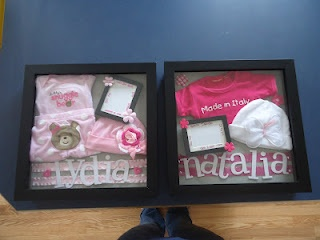 Made shadow boxes of the girl's coming home outfits from the hospital. Just needs pictures of them in their outfits for the frames. I put their birth details around the matting in the frames. =)