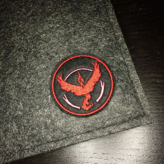 What better way to show pride for your team than to have a Team Valor patch! This premium patch embroidered with vivid colours on a durable felt base. It measures approximately 2.0 x 2.0  This patch can be sewn or ironed on to your favorite knapsacks, jeans or jackets. For removable options, choose our pin backed version that has a bar pin fastened to the back.